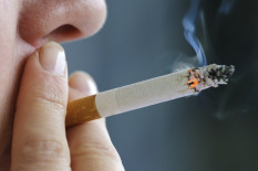 Someone smaoking a cigarette | Pic: Getty