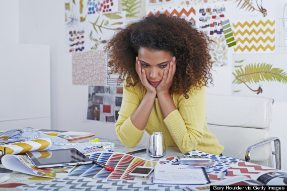 unhappy black woman office