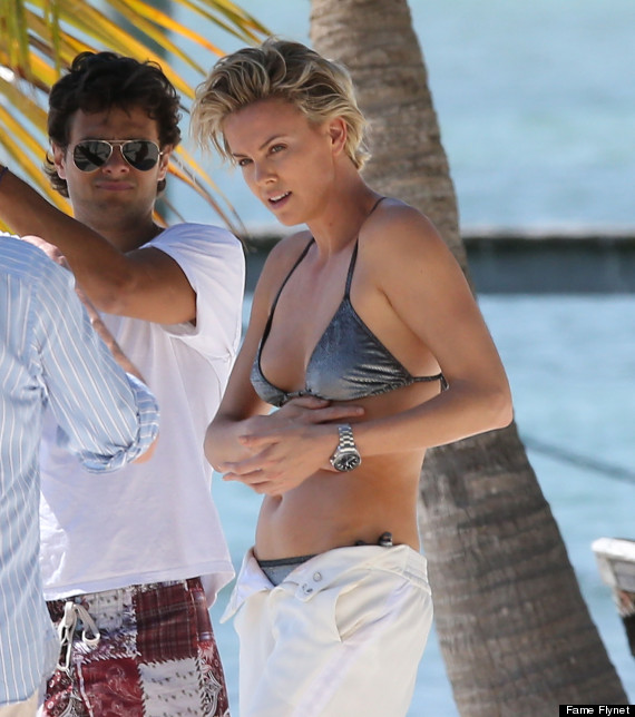 Dons A Bikini Photo Miami Theron For Charlize ShootHuffpost eWEH9IDY2b