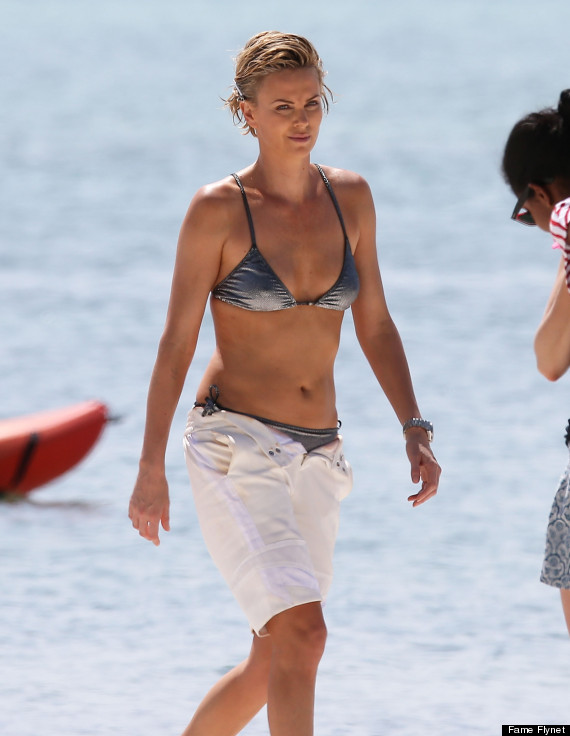 Charlize theron dons a bikini for miami photo shoot huffpost charlize theron voltagebd Gallery