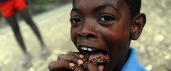 HAITI CHILD EATING