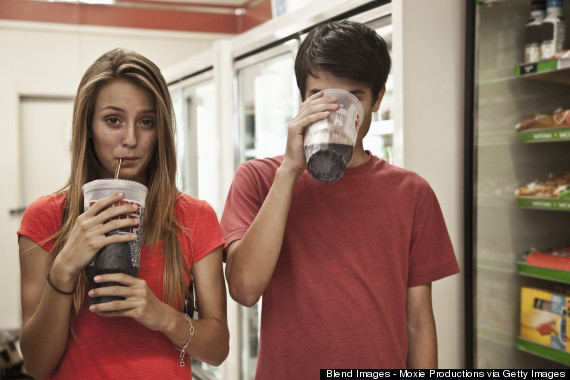 teenagers drinking soda