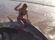 Girl Poses With Dead Shark, Prompts Warning Not To Touch Dead Sharks
