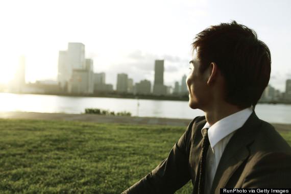 man in suit sunset