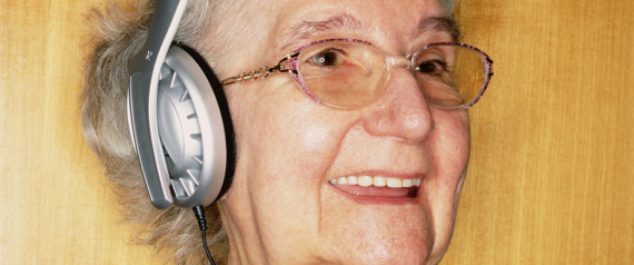 OLD WOMAN WITH HEADPHONES