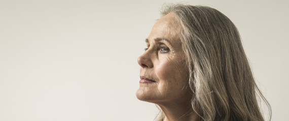WOMAN LOOKING AT HER WRINKLES