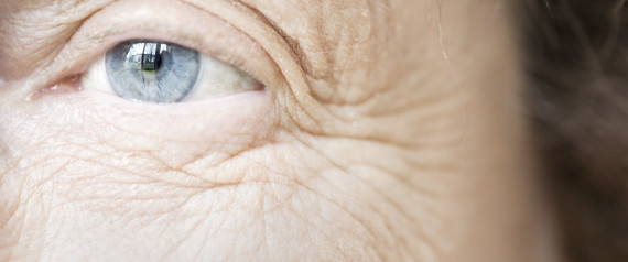 woman looking at her wrinkles