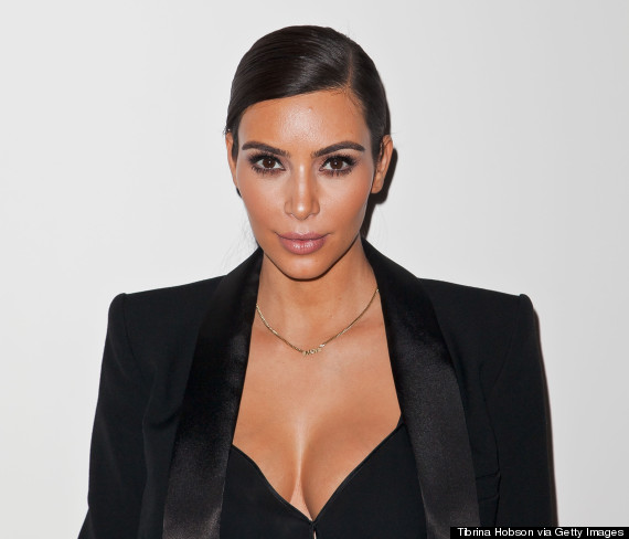 kim kardashian wears plunging top with menswear inspired look huffpost