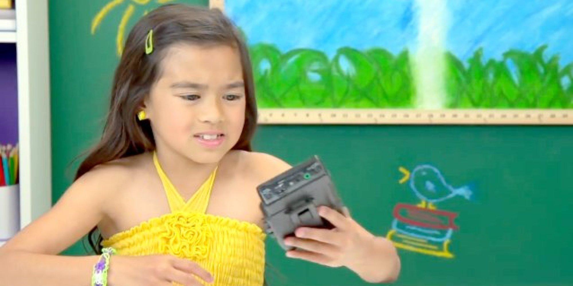 Watch kids react to odd black bricks formerly known as walkmans