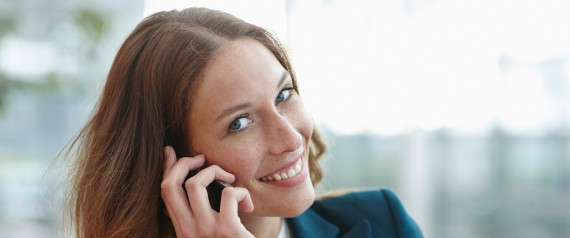 WOMAN IN SUIT ON CELL PHONE