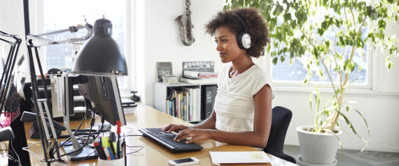 WOMAN IN HEADPHONES IN OFFICE