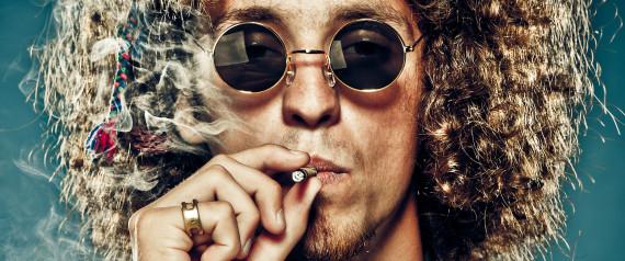 MAN SMOKES JOINT