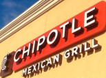 Mom Changes Baby's Diaper On Dining Table In Chipotle