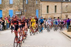 Cyclists ride through streets | Pic: Alamy