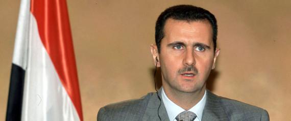 SYRISCHER PRSIDENT ASSAD NEBEN FLAGGE