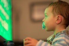A child looking at a screen | Pic: Getty