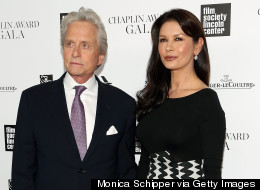 Michael Douglas & Catherine Zeta-Jones Hold Hands On The Red Carpet