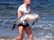 MMA Fighter Tries To Rescue Dolphin That Washed Ashore
