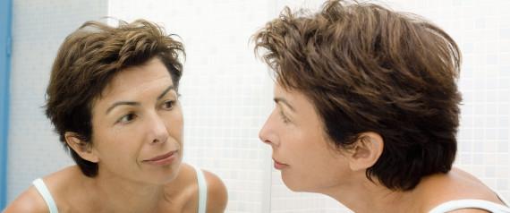 WOMAN LOOKING AT WRINKLES