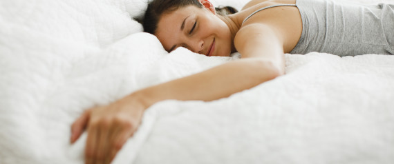 WOMAN HAPPY ALONE BED