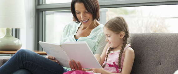 MOM READING TO DAUGHTER
