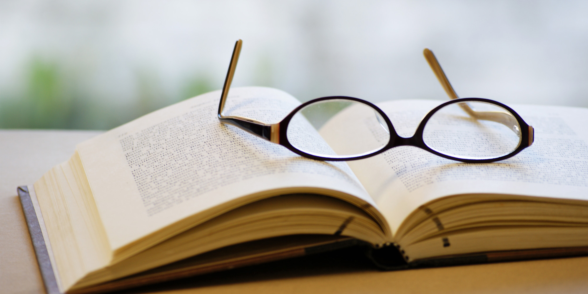 glasses on book - photo #9