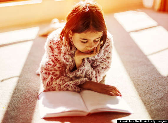 indian girl reading a book