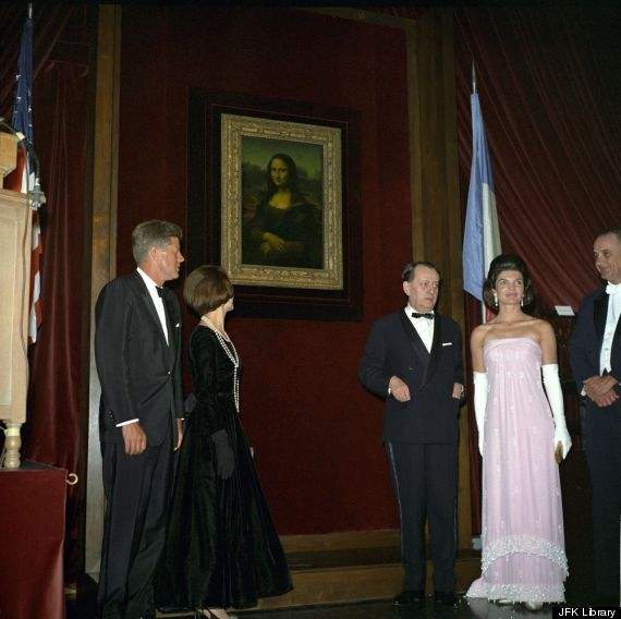 john and jacqueline kennedy attend the opening of
