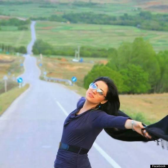 iranian woman removes headscarf