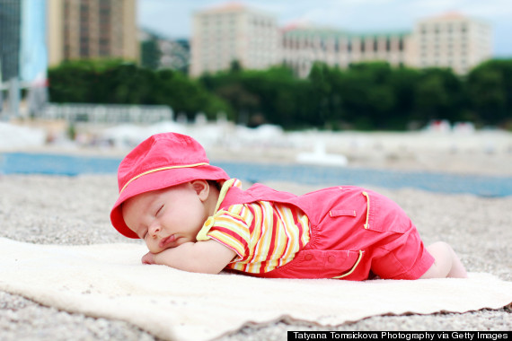 baby sleeping beach