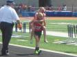 Twin Carries Injured Sister Across The Finish Line At 800-Meter Race (VIDEO)