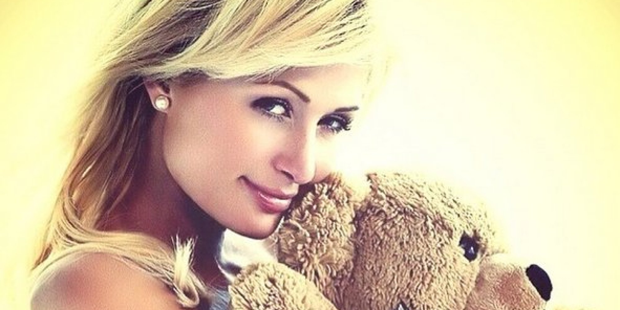 Paris Hilton Poses Topless While Hugging A Teddy Bear On
