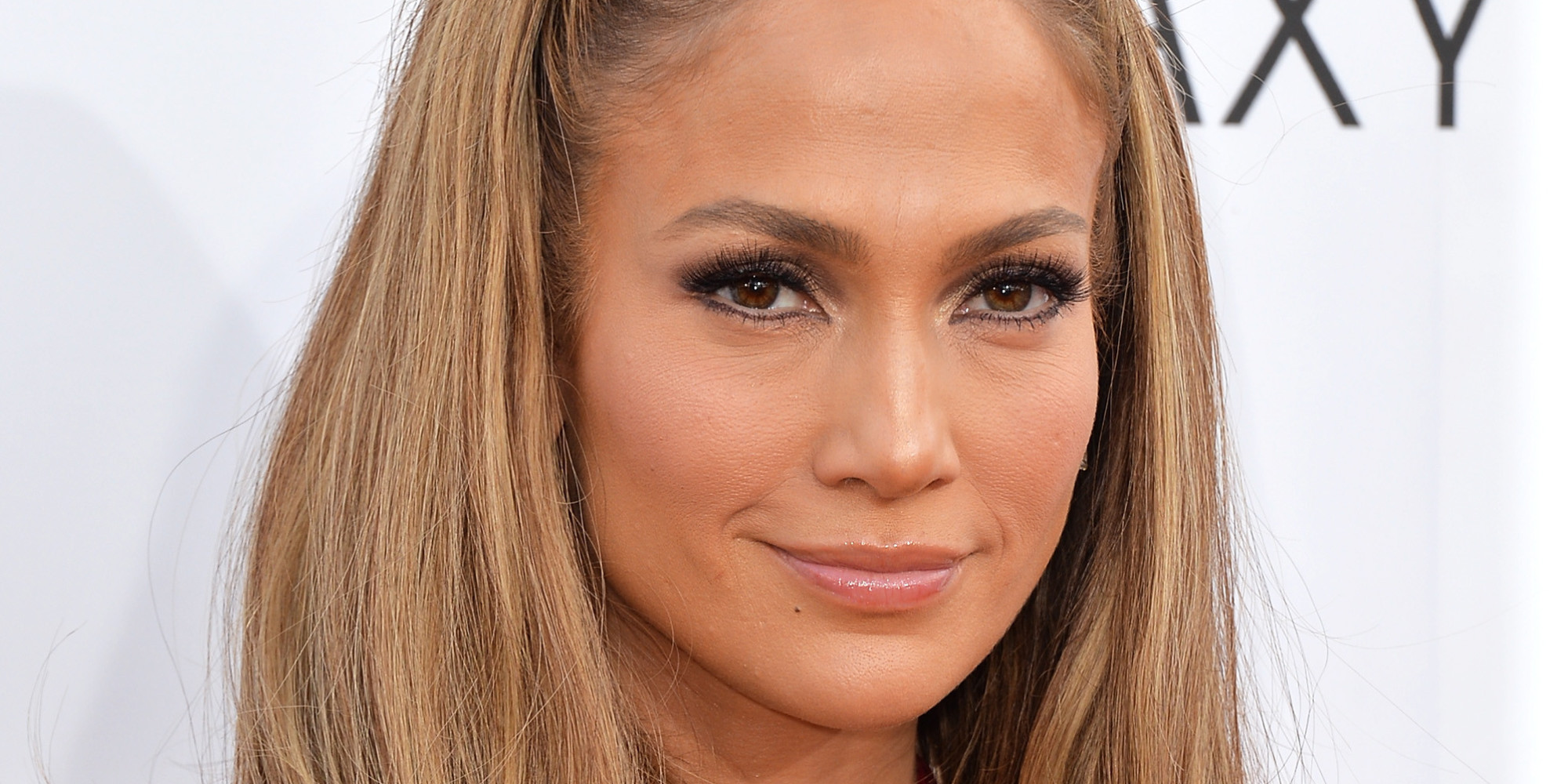 Jennifer Lopez Shows A Lot Of Leg In Donna Karan Dress At The 2014 ... Jennifer Lopez