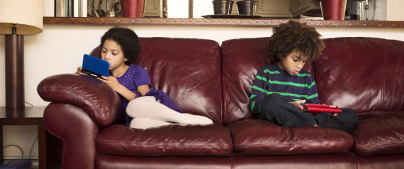 KID SITTING COUCH