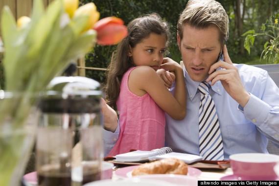 on phone ignoring child