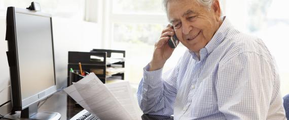 happy older man at his desk