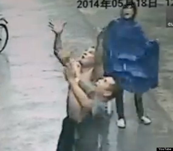 men catch falling baby