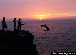 WATCH: These Insane Cliff Divers Just Upped The Ante On Summer