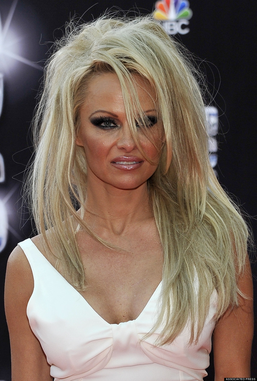 Pamela Anderson Ditches Pixie Cut For Long Hair Extensions!
