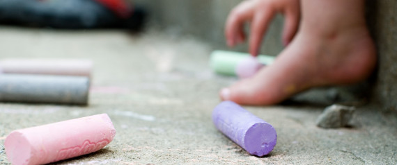 TODDLER WITH SIDEWALK CHALK