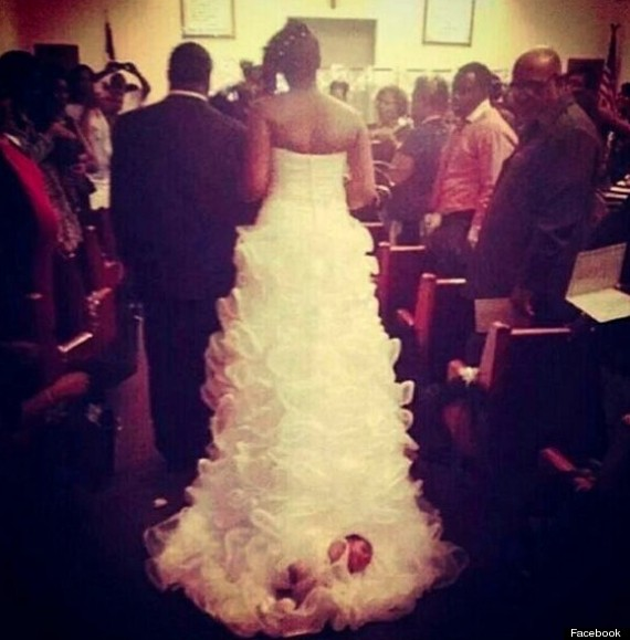 baby sewn to wedding dress