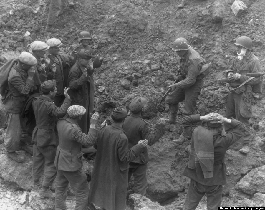 a us soldier holds a group of german troops