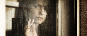 Sad Looking Older Woman Looking Out Window