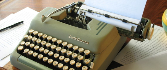 typing a paper on a typewriter