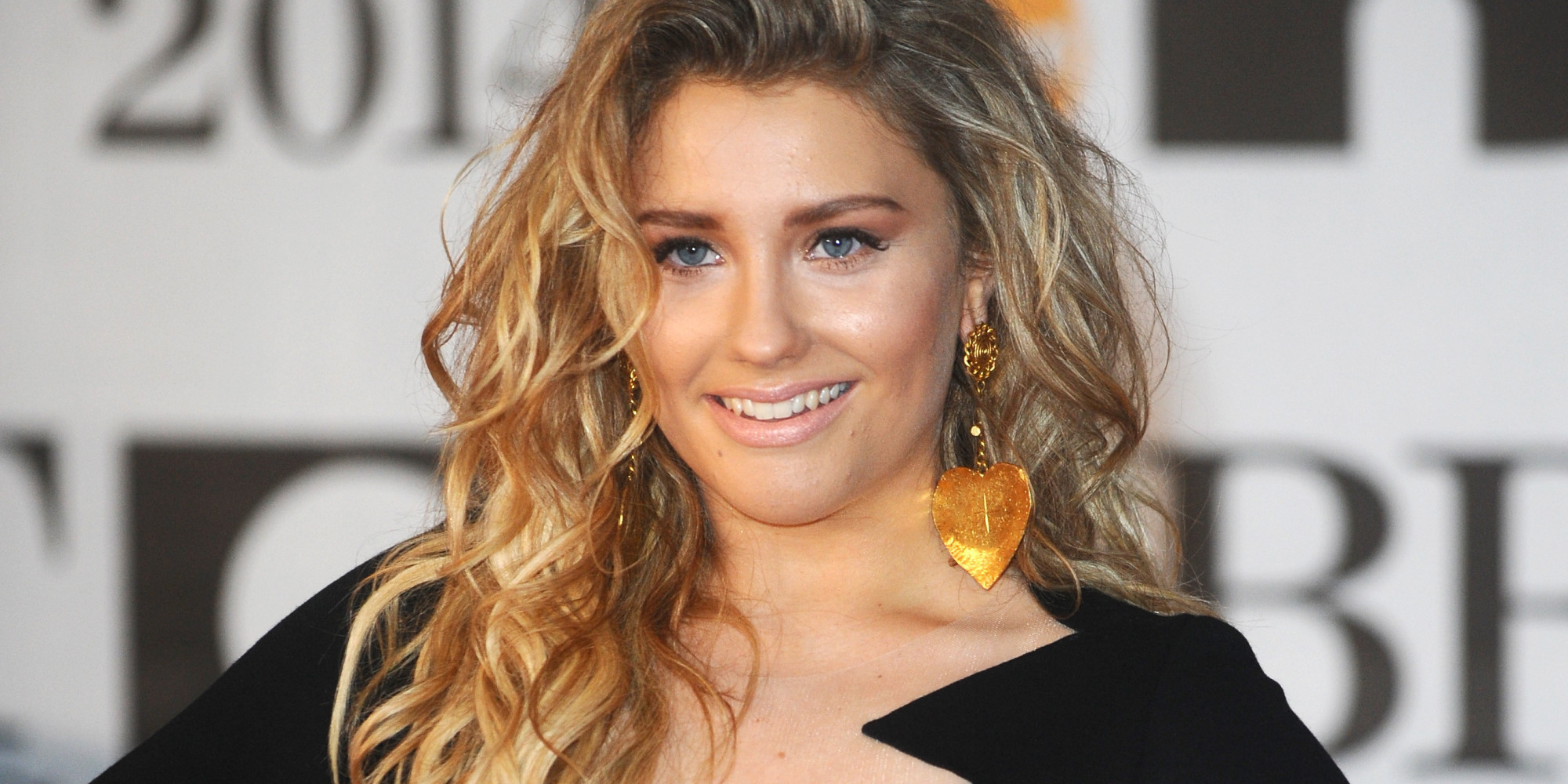 The 21-year old daughter of father Sean and mother Michelle, 162 cm tall Ella Henderson in 2017 photo