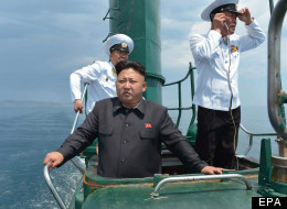 In The Navy! Kim Jong Un Poses Nobly Atop Ageing Submarine (PICTURES)