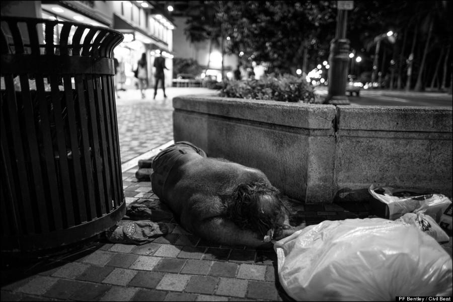 sleeping beside trash