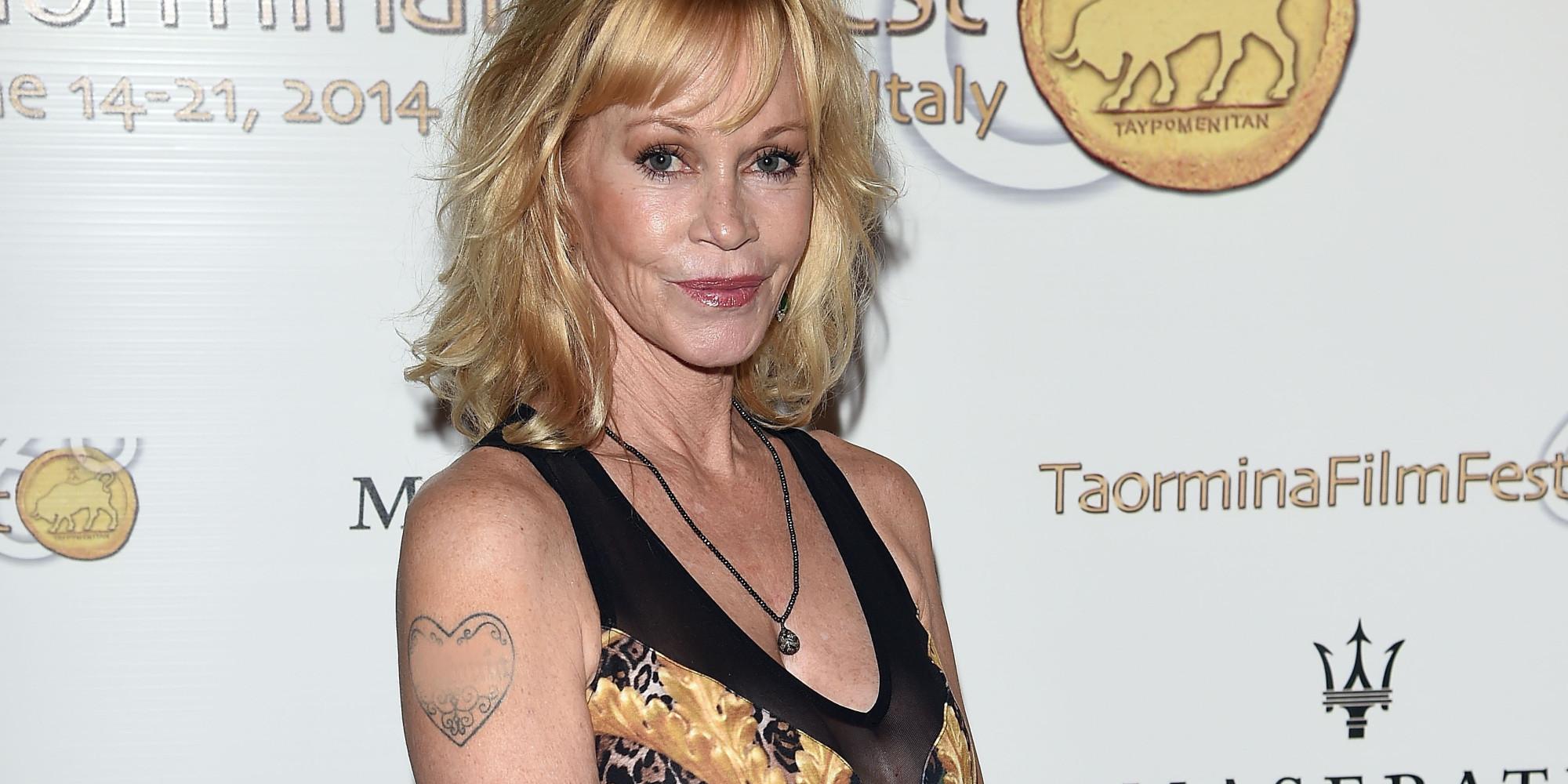 Melanie griffith covers antonio banderas tattoo following for Melanie griffith tattoo