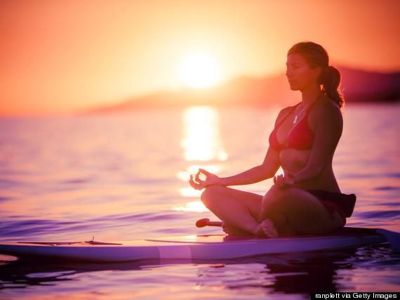 sit on surfboard