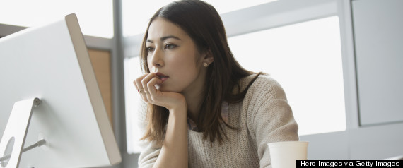 woman concentrating desk